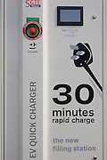 "SGTE fast charger technology for electric vehicles at a charging point offering an EV 30 minute charge. CHAdeMO (sometimes spelled CHdeMO) is the trade name of a quick charging method for battery electric vehicles delivering up to 62.5 kW of high-voltage direct current via a special electrical connector. CHAdeMO is an abbreviation of ""CHArge de MOve"", equivalent to ""charge for moving"". The name is a pun for O cha demo ikaga desuka in Japanese,[translating to English as ""How about some tea?"", referring to the time it would take to charge a car. CHdeMO can charge a car in less than half an hour."
