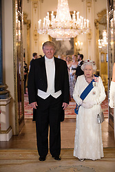 US President Donald Trum and Queen Elizabeth II during a group photo ahead of the State Banquet at Buckingham Palace, London, on day one of US President Donald Trump's three day state visit to the UK.