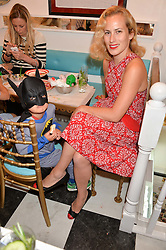 CHARLOTTE DELLAL and her son IKE CREWE at a party to launch Biscuiteers Fashion Biscuit Collection inspired by Alice Naylor-Leyland's wardrobe held at Biscuiteers, 194 Kensington Park Road, London W11 on 23rd June 2015.