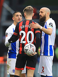 Brighton & Hove Albion's Anthony Knockaert (left) and Bruno Saltor (right) speak with Bournemouth's David Brooks during the Emirates FA Cup, third round match at the Vitality Stadium, Bournemouth.