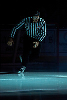 KELOWNA, BC - DECEMBER 18: Linesman Dustin Minty skates on the ice at the start of the game between the Kelowna Rockets and the Vancouver Giants at Prospera Place on December 18, 2019 in Kelowna, Canada. (Photo by Marissa Baecker/Shoot the Breeze)