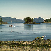 "This is the entrance on the West side that faced Admiralty Island. To the right of the photo you can see the distinctive outline of the hills that creates ""the Sleeping Giant"", as everybody called it. Later on when I was just kayaking, I still liked to stop here to camp because there was a very good place to camp near where I took this photo from. In the opposite direction behind this beach was a small island that was used as a haul-out by Steller sea lions. Whenever they were there you could constantly hear their rumbling groaning and roaring. There is also a lot of seal and seabird activity around the island, and particularly around the kelp beds. One of the regular seabirds there are pigeon guillemots (Cepphus columba), with their distinctive high-piched squeaking. Humpback whales also frequently feed in the nutrient-rich waters around the island, as a result of the strong upwelling created by strong currents colliding. I had my first close encounter with humpback whales lunge-feeding right next to the rocky shoreline of one of the islands."