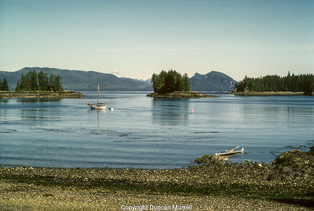 """This is the entrance on the West side that faced Admiralty Island. To the right of the photo you can see the distinctive outline of the hills that creates """"the Sleeping Giant"""", as everybody called it. Later on when I was just kayaking, I still liked to stop here to camp because there was a very good place to camp near where I took this photo from. In the opposite direction behind this beach was a small island that was used as a haul-out by Steller sea lions. Whenever they were there you could constantly hear their rumbling groaning and roaring. There is also a lot of seal and seabird activity around the island, and particularly around the kelp beds. One of the regular seabirds there are pigeon guillemots (Cepphus columba), with their distinctive high-piched squeaking. Humpback whales also frequently feed in the nutrient-rich waters around the island, as a result of the strong upwelling created by strong currents colliding. I had my first close encounter with humpback whales lunge-feeding right next to the rocky shoreline of one of the islands."""