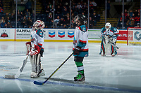 KELOWNA, CANADA - JANUARY 3: Two mini minor hockey players stand on the ice as the Pepsi players of the game at the Kelowna Rockets against the Tri-City Americans on January 3, 2017 at Prospera Place in Kelowna, British Columbia, Canada.  (Photo by Marissa Baecker/Shoot the Breeze)  *** Local Caption ***