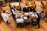 Overview, Men eating lunch, Al-Quds Restaurant, Downtown Amman, Jordan.
