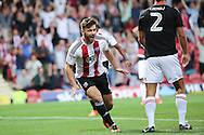 Brentford forward Scott Hogan (9)  celebrating scoring opening goal of game 1-0 during the EFL Sky Bet Championship match between Brentford and Nottingham Forest at Griffin Park, London, England on 16 August 2016. Photo by Matthew Redman.