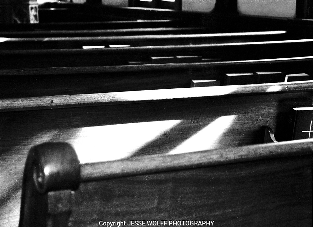 The pews being lit up at an old church in Georgetown, Colorado.  My uncle's father was pastor at this church for a bit.