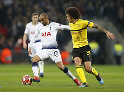 BRITAIN-LONDON-FOOTBALL-UEFA CHAMPIONS LEAGUE-TOTTENHAM VS DORTMUND.(190213) -- LONDON, Feb.13, 2019  Tottenham Hotspur's Lucas Moura (L) gets away from Borussia Dortmund's Axel Witsel (R) during the UEFA Champions League Round of 16 1st Leg match between Tottenham Hotspur and Borussia Dortmund at Wembley Stadium in London, Britain on Feb. 13, 2019. Tottenham Hotspur won 3-0.  FOR EDITORIAL USE ONLY. NOT FOR SALE FOR MARKETING OR ADVERTISING CAMPAIGNS. NO USE WITH UNAUTHORIZED AUDIO, VIDEO, DATA, FIXTURE LISTS, CLUB/LEAGUE LOGOS OR ''LIVE'' SERVICES. ONLINE IN-MATCH USE LIMITED TO 45 IMAGES, NO VIDEO EMULATION. NO USE IN BETTING, GAMES OR SINGLE CLUB/LEAGUE/PLAYER PUBLICATIONS. (Credit Image: © Xinhua via ZUMA Wire)