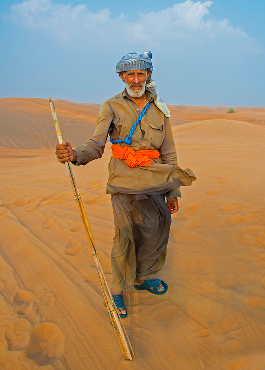 Camel hearder in the Dubai desert .