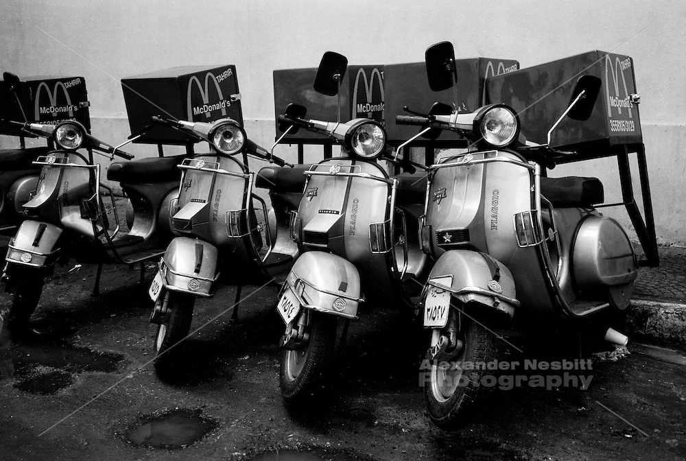 Cairo, Egypt - The downtown McDonalds delivers by Vespa scooter.