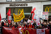 Food service industry workers strike for higher wages on October 4th 2018 in Leicester Square, London, United Kingdom. Day of action by workers from TGI Fridays, McDonalds; Deliveroo and Wetherspoons, supported by TUC and Labour Party, demanding better conditions for the hospitality sector. Demonstrators gather outside McDonalds Leicester Square.