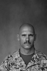 """Forward Air Controller Capt. Jeffrey """"Caveman"""" Pulskamp, 31, Batesville, Indiana, Kilo Co., 3rd Battalion 1st Marines, 1st Marine Division, United States Marine Corps at the company's firm base in Haditha, Iraq on Oct. 22, 2005."""