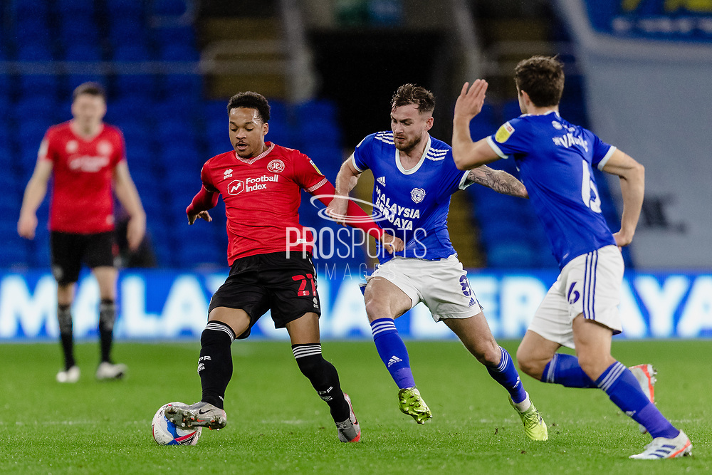 Queens Park Ranger's Chris Willock and Cardiff City Joe Ralls tussle for the ball during the EFL Sky Bet Championship match between Cardiff City and Queens Park Rangers at the Cardiff City Stadium, Cardiff, Wales on 20 January 2021.