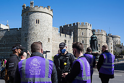 Windsor, UK. 17th April, 2021. Thames Valley Police officers and community wardens from the Royal Borough of Windsor and Maidenhead converse in front of Windsor Castle on the day of the funeral of the Duke of Edinburgh. The funeral of Prince Philip, Queen Elizabeth II's husband, is taking place at St George's Chapel in Windsor Castle, with the ceremony restricted to 30 mourners in accordance with current coronavirus restrictions.