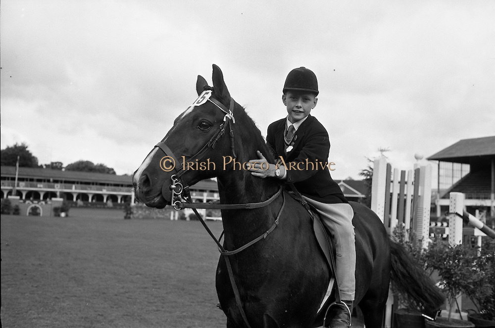 RDS Horse Show. Robert Taylor, who rode Dandy to victory in the Childrens Jumping Competition, patting the pony after the win..08.08.1963