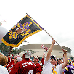 Jan 9, 2012; New Orleans, LA, USA; LSU Tigers fan Harry Cannon waves a flag before the 2012 BCS National Championship game against the Alabama Crimson Tide at the Mercedes-Benz Superdome.  Mandatory Credit: Derick E. Hingle-US PRESSWIRE
