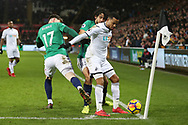 Martin Olsson of Swansea city holds off Oliver Burke (l) and Ahmed Hegazi of West Bromwich Albion.Premier league match, Swansea city v West Bromwich Albion at the Liberty Stadium in Swansea, South Wales on Saturday 9th December 2017.<br /> pic by  Andrew Orchard, Andrew Orchard sports photography.