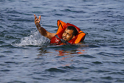 A refugee swims to the shore of Lesbos after he jumped off from the boat carrying them. Hundreds of refugees, mainly from Syria, Iraq and Afghanistan are still coming to the Greek island of Lesbos on a daily basis, after making the dangerous trip from the nearby Turkish coast in small inflatable boats. lesbos, Greece, September 9, 2015. Photo by Michael Debets/Pacific Press/ABACAPRESS.COM    515147_001 Lesbos Grèce Greece