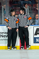 KELOWNA, BC - JANUARY 3:  Referees Mark Pearce and Trevor Nolan stand at the timekeepers box during a time out at the Kelowna Rockets against the Victoria Royals at Prospera Place on January 3, 2020 in Kelowna, Canada. (Photo by Marissa Baecker/Shoot the Breeze)