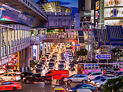 """22 MAY 2014 - BANGKOK, THAILAND:  Traffic on Sukhumvit Road at Asoke in Bangkok tries was gridlocked after the army declared an overnight curfew. The Thai army suspended civilian rule, suspended the constitution and declared the """"military takeover of the nation."""" The announcement came just before evening as a meeting between civilian politicians and the army was breaking up with no progress towards resolving the country's political impasse. Civilian politicians were arrested when the meeting ended. The army also declared a curfew from 10PM until 5AM.   PHOTO BY JACK KURTZ"""