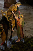 """Joseph helping Mary down from a camel during the Flight into Egypt from """"Nacimiento Las Palomas"""" at San Pablo, Oaxaca, Mexico."""