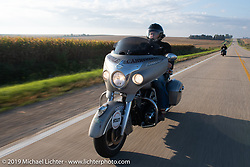 Race director Jason Sims rides his modern Indian during the Motorcycle Cannonball coast to coast vintage run. Stage 7 (274 miles) from Cedar Rapids to Spirit Lake, IA. Friday September 14, 2018. Photography ©2018 Michael Lichter.