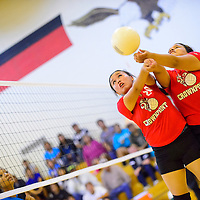 091913  Adron Gardner/Independent<br /> <br /> Crownpoint Eagle Kyla Yazzie (20), left, and Tristan Craig (22) reach for a save during a match against the Navajo Prep Eagles in Crownpoint Thursday.