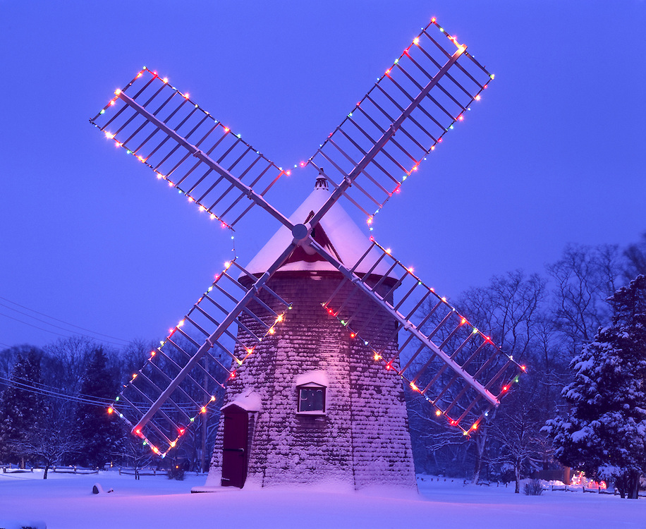 Historic windmill at dusk, with Christmas lights after winter storm, Eastham, Cape Cod, MA