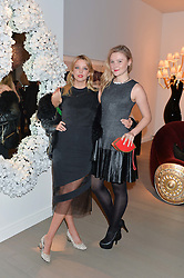 Left to right, GRETA BELLAMACINA and AMBER ATHERTON at the PAD London 2014 VIP evening held in the PAD Pavilion, Berkeley Square, London on 14th October 2014.