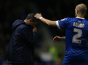 Brighton manager Chris Hughton gets a ball in the face during the Sky Bet Championship match between Brighton and Hove Albion and Derby County at the American Express Community Stadium, Brighton and Hove, England on 3 March 2015.