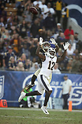 Los Angeles Rams wide receiver Sammy Watkins (12) leaps while trying to catch a deep pass broken up by an unidentified defender during the 2017 NFL week 12 regular season football game against the New Orleans Saints, Sunday, Nov. 26, 2017 in Los Angeles. The Rams won the game 26-20. (©Paul Anthony Spinelli)