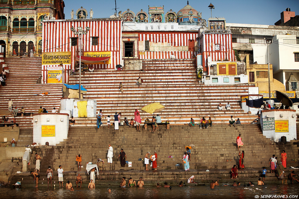 Hindus gather at one of many vibrant ghats to bathe in the Ganges River of Varanasi, India.