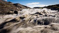 Við Rauðuflúð í Jökulsá á Brú. Þessi staður er ekki lengur til þar sem hann fór undir Hálslón Kárahnjúkavirkjunar. Andri Snær Magnason sést í fjarska...By Raudaflud in glacier river Jökulsá á Brú. This magnificent place no longer exist due to the Hálslón Reservoir which was made for Kárahnjúkavirkjun Hydro Power Plant in Iceland.