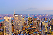View of the Manhattan skyline and office buildings, including the MetLife Building, from Top of the Rock Observation Deck at twilight, New York City.