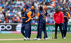 India's Virat Kohli celebrates the wicket of England's Eoin Morgan, caught by Kedar Jadhav bowled by Mohammed Shami, during the ICC Cricket World Cup group stage match at Edgbaston, Birmingham.