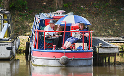 © Licensed to London News Pictures. 04/09/2021. Brecon, UK. People enjoy their lunch whilst on the Monmouthshire and Brecon Canal in South Wales on a beautiful Saturday afternoon as people enjoy the late Summer weather across the UK. Photo credit: Robert Melen/LNP