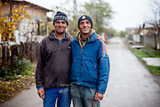 Portrait of Dan and Laurentio - two young Roma reconstruction workers on the way to their building site in Marginenii de Jos.