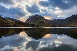 © Licensed to London News Pictures. 13/01/2016. Buttermere UK. Picture shows this mornings sunrise reflecting in Buttermere lake in the lake district.Photo credit: Andrew McCaren/LNP