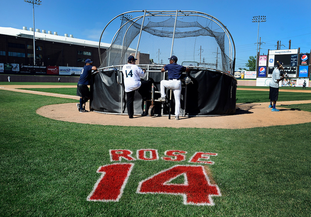 Pete Rose, left, talks to Willie Upshaw, right, as they watch batting practice at The Ballpark at Harbor Yard, Monday, June 16, 2014, in Bridgeport, Conn. Rose, banned from Major League Baseball, returned to the dugout for one day to manage the independent minor-league Bridgeport Bluefish. (AP Photo/Jessica Hill)