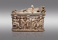 """Roman relief sculpted sarcophagus of Domitias Julianus and Domita Philiska depicted reclining on the lid, 2nd century AD, Perge. Antalya Archaeology Museum, Turkey.. Against a grey background.<br /> <br /> it is from the group of tombs classified as. """"Columned Sarcophagi of Asia Minor"""". <br /> The lid of the sarcophagus is sculpted into the form of a """"Kline"""" style Roman couch on which lie Julianus &  Philiska. This type of Sarcophagus is also known as a Sydemara Type of Tomb. .<br /> <br /> If you prefer to buy from our ALAMY STOCK LIBRARY page at https://www.alamy.com/portfolio/paul-williams-funkystock/greco-roman-sculptures.html . Type -    Antalya    - into LOWER SEARCH WITHIN GALLERY box - Refine search by adding a subject, place, background colour, etc.<br /> <br /> Visit our ROMAN WORLD PHOTO COLLECTIONS for more photos to download or buy as wall art prints https://funkystock.photoshelter.com/gallery-collection/The-Romans-Art-Artefacts-Antiquities-Historic-Sites-Pictures-Images/C0000r2uLJJo9_s0"""