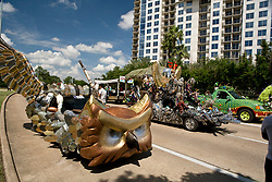 """Stock photo of the Houston Art Car Parade 2012 - (closest to furthest)  """"Centenni-Owl"""" - Artist: Rice University Art Car Class under the direction of Richard Carter  /  """"Earth, Wind & Fire... and Water"""" - Artist: Jefferson Davis High School under the direction of Rebecca Bass / """"Last Concert Cafe's Journey to the Other Side featuring The Hightailers & The Tribal Lillies"""" - Artist: Dawn Fudge and gang"""