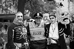 17 Feb 2015. New Orleans, Louisiana.<br /> Mardi Gras Day. Walking with Skeletons. <br /> Posing with police. The Skeleton Krewe meets before dawn beside a cemetery in Uptown New Orleans. They then walk several miles Along Saint Charles Avenue to the French Quarter to celebrate Mardi Gras Day.<br /> Photo; Charlie Varley/varleypix.com