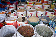 Bags of rice, pulses and spices on offer in a food shop along the main street through the centre of Besishahar on the 10th of March 2020, Besishahar, Lamjung District, Gandaki Pradesh, Nepal. Besishahar is a small town, municipality and the district headquarters of Lamjung District in Gandaki Pradesh, Nepal.