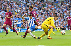 12 August 2017 - Premier League Football - Brighton & Hove Albion v Manchester City - Man City goalkeeper Ederson Moraes comes out to make a save as Jamie Murphy of Brighton and Kyle Walker of Man City lose control of the ball - Photo: Charlotte Wilson