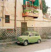 An old Fiat  car parked in the street in the old city of Damascus, Syria