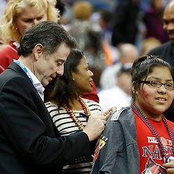 Apr 9, 2013; New Orleans, LA, USA; Louisville Cardinals men's basketball head coach Rick Pitino (left) signs an autograph for a fan before the championship game in the 2013 NCAA womens Final Four against the Connecticut Huskies at the New Orleans Arena. Mandatory Credit: Derick E. Hingle-USA TODAY Sports