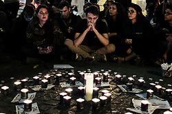 April 28, 2018 - Jerusalem, Israel - Mourners gather for an emotional candlelight vigil to remember the 10 young victims of a flash flood in the Arava Desert Tzafit River Thursday, 26th April, 2018. Among the victims partaking in a pre-military educational program hiking trip in the popular Tzafit River canyon trail were Yael Sadan, 19, and Maayan Barhum, 18, from Jerusalem. (Credit Image: © Nir Alon via ZUMA Wire)