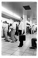 Commuter with briefcase on the Tokyo subway, Japan. 1987.