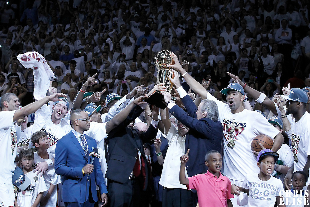 21 June 2012: Miami Heat players, coaches and owner hold the Championship trophy after the Miami Heat 121-106 victory over the Oklahoma City Thunder, in Game 5 of the 2012 NBA Finals, at the AmericanAirlinesArena, Miami, Florida, USA. The Miami Heat wins the series 4-1.