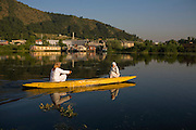 Two Kashmiri ladies paddle to and from their house boat on Dal lake. Travel photographs of Srinagar, Kashmir, Jammu & Kashmir, India on 9th June 2009.  Photo by Suzanne Lee /  For The National